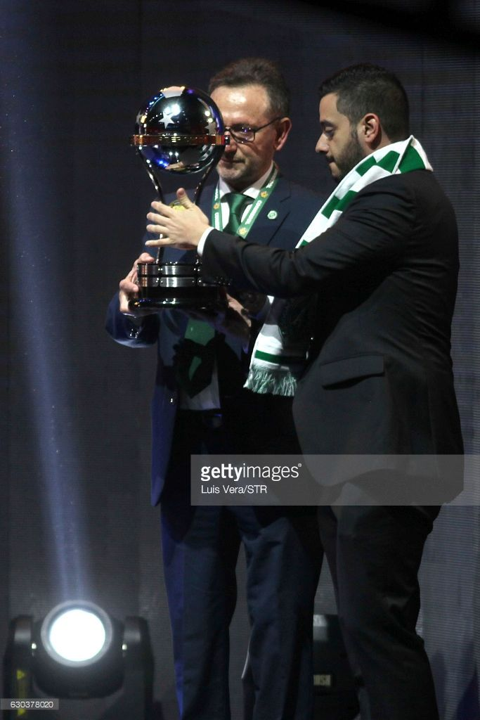 Plinio David De Nes Filho president of Chapecoense (L) and Daniel Jimenez Ochoa Director of Human Management of Club Atletico Nacional de Medellin (R) share the Copa Sudamericana Trophy during the Copa Libertadores 2017 Official Draw at Conmebol Convention Center on December 21, 2016 in Luque, Paraguay.