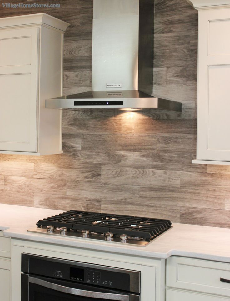 Porcelain Floor Tile With A Gray Woodgrain Pattern Is Installed As A Backsplash In