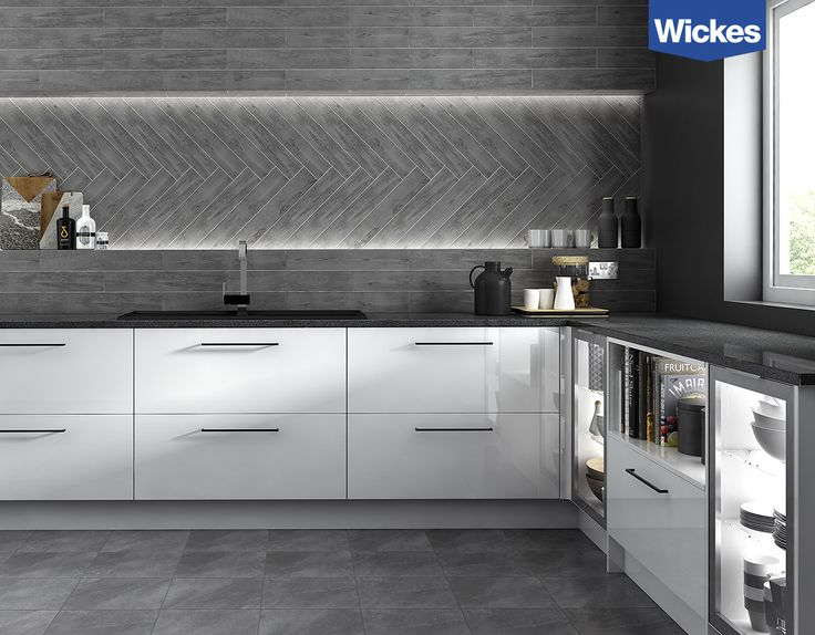 Contrast high gloss dazzling white cabinets with a statement black quartz worktop. Match sleek chrome handles, taps and accessories to create an industrial chic look. Continue the monochrome theme on the walls and floor with urban grey and timber effect tiles, use bespoke feature lighting to create dramatic impact. Get creative and mix tile patterns to reflect your unique style.