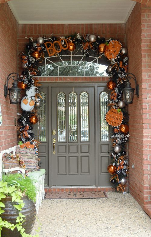 did you know you can use your green garland from christmas as your base for decorating your door for fallhalloween save yourself some money on the garland