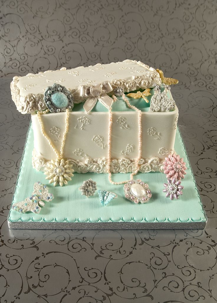 A jewelry box cake that I made for the Cake Craft and Decoration Magazine using our Brooch mould and our Butterfly Brooch mould www.karendaviesca...