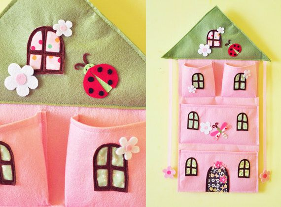 Felt & Fabric Pink House Bow Holder and wall by AContinualFeast... I love this! How perfect for your little girl to tuck away all her little things that can junk up a dresser!