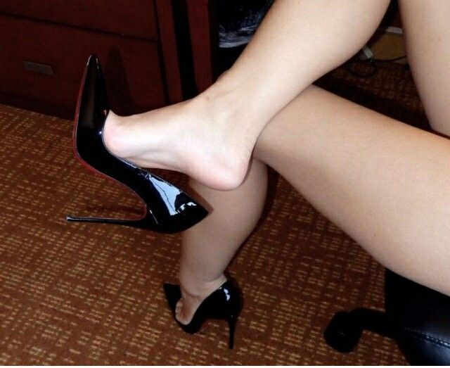 Black patent pumps, arches, great legs, and toe cleavage