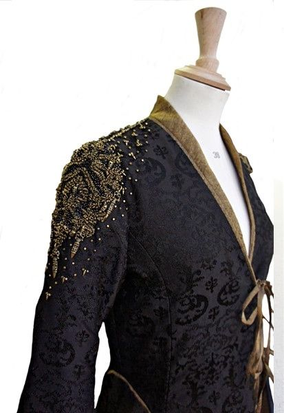 We see Cersei mourning the death of her son, the late King Joffery, in a black brocade gown accented with Lannister gold embroidery. She wears this gown to stand in vigil, with her son Tommen, over...