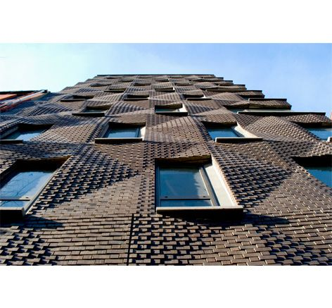 290 Mulberry Street Condiminiums, New York, Ny, by shop architects; the bricks are integral to a precast concrete panel, which is repeated in a standardized pattern
