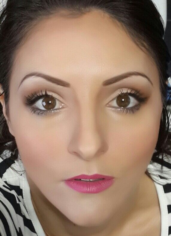 Neutral eyes with very fashionable bright pink lip