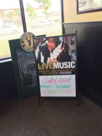 Menu options, happy hour specials  and live music advertising at Fionn MacCool's on Regent Avenu