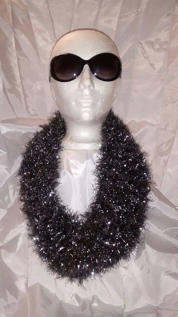 Check out this item in my Etsy shop https://www.etsy.com/listing/271096698/sparkly-shiny-hand-knitted-cowl