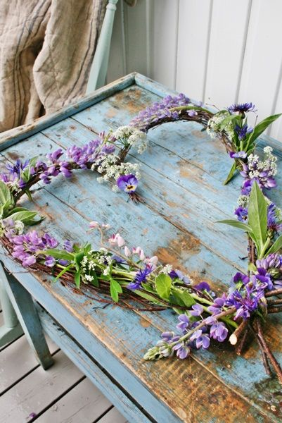 This would be easy to make with small, green branches from a tree limb, twist ties, and putting in fresh cut flowers or fake flowers.