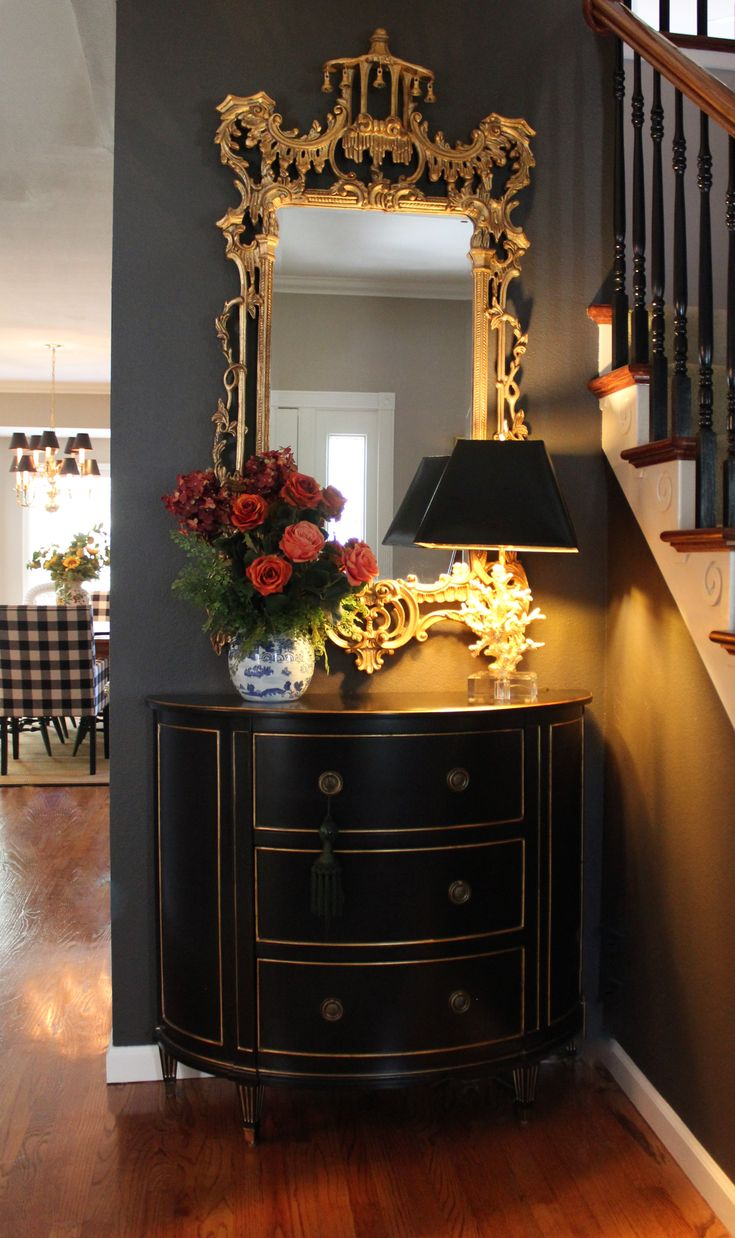 Stunning entry! # Ethan Allen Coral lamp, Chinoisere mirror, Stratton chest in Black and gold #Sherwin Williams- Black fox wall,