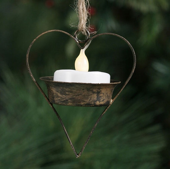 Tea Light Ornament.  Use electric tea light and hang in a tree.  $4.00