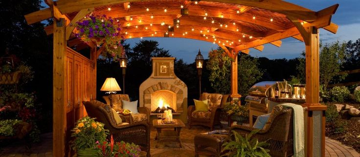 Create an outdoor room with a stately pergola. These versatile and beautifully-built structures provide shade and define a space. Wicker furniture is ideal for creating a conversation area, and unique lighting adds a festive ambiance. Planters and fireplaces complete the cozy feel.