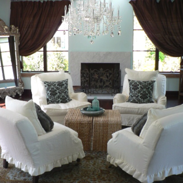 Who needs sofas?? Great conversation area with comfy slip-covered chairs! Cozy room....yet formal and classic!