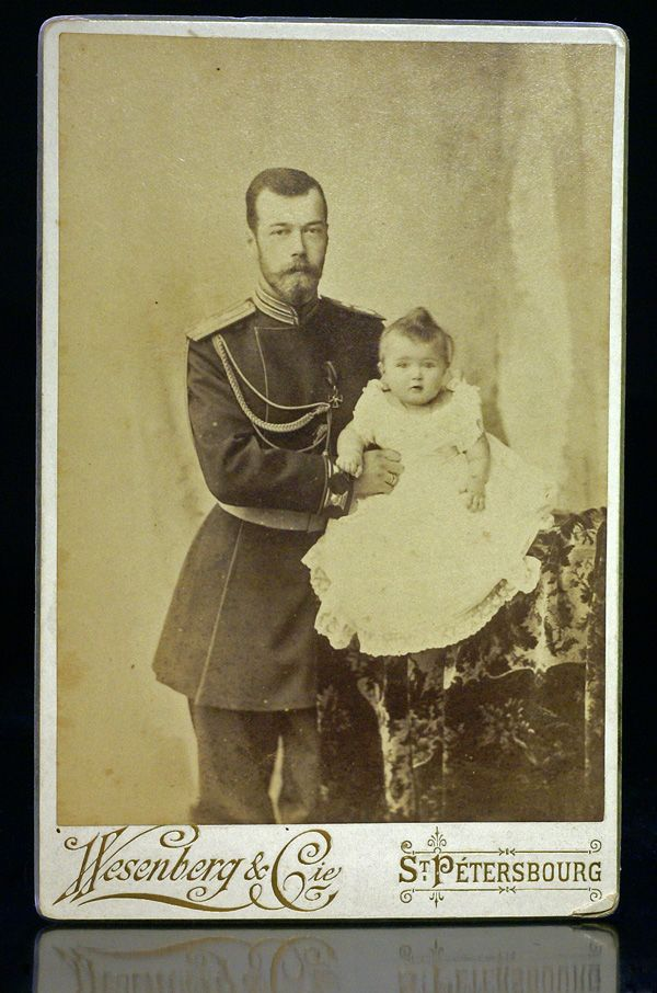 Photograph of Czar Nicholas II and his first child, Grand Duchess Olga, by St. Petersburg photographer Wesenberg, 1896.