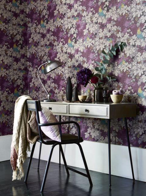 Decorate with shades of berry: Let your imagination run wild in a study space decorated with a whimsical wallpaper. Simple furniture with clean lines allows the paper to be the star of the show. Find more style inspiration at housebeautiful.co.uk. (Photography by Rachel Whiting | Styling by Hannah Deacon)
