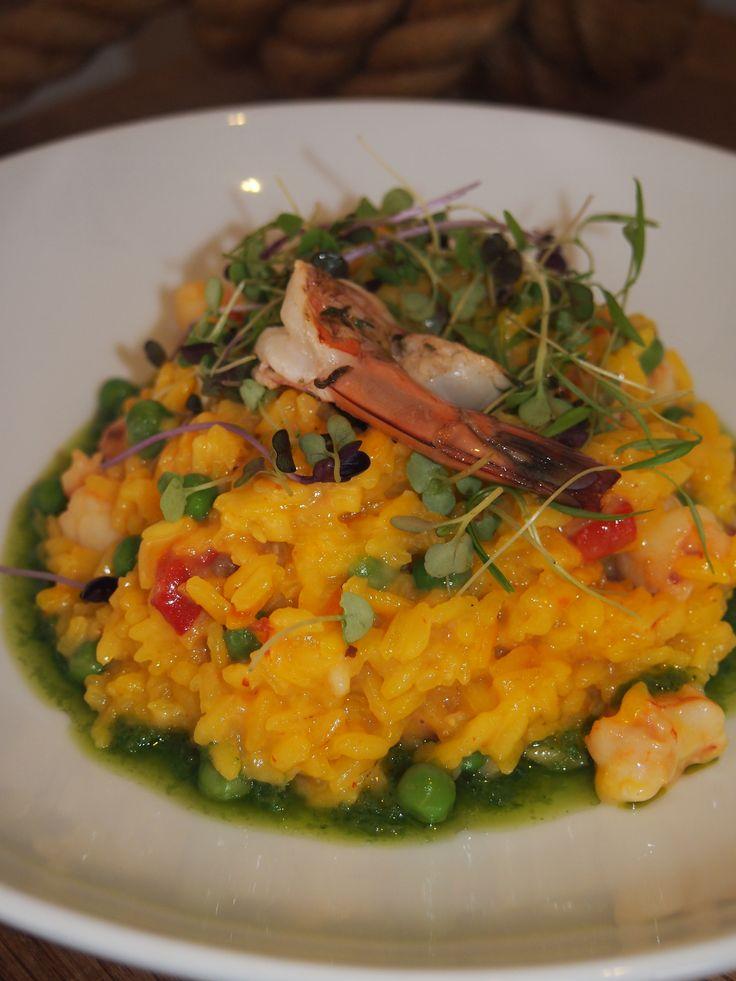 Saffron risotto, king prawns, green peas, roasted capsicum, mascarpone, chive oil.