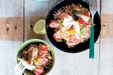 Mexican rice, corn and fish salad with coriander and lime