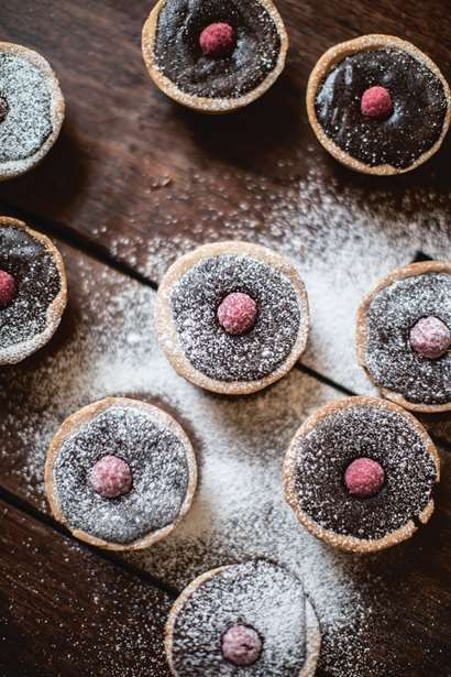 Dark chocolate and raspberry tarts.