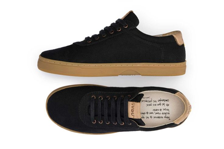 THE CO.4 BLACK AND GUM BASIC. If white isn't your thing, look no further. This sneaker matches black stitching and black paneled upper canvas with the 100% natural sole color. The nude leather really stands out against the black design. The insole comes with an original Colombian poem.