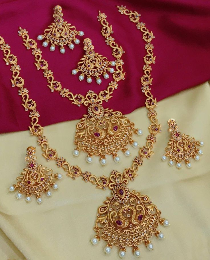Beautiful necklace nad long haram with swimming swan design pendent. both studded with pink and white color stones. 02 September 2017