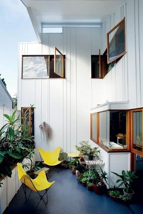 A balcony off the kitchen makes the most of the constrained outdoor space.