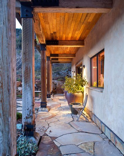 Straw Bale House. Rustic patio by KuDa Photography