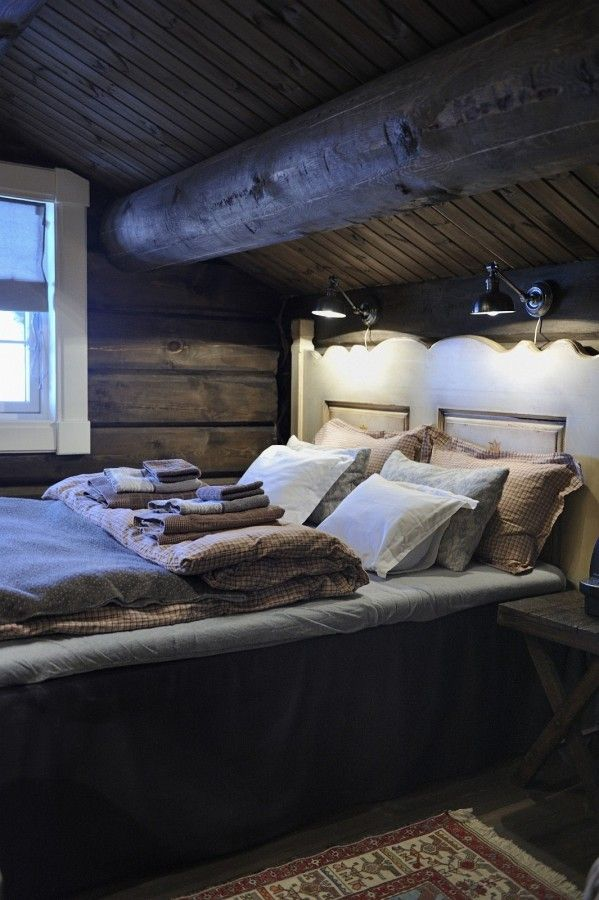 This would be a great guest room; cozy, beams, layered linens
