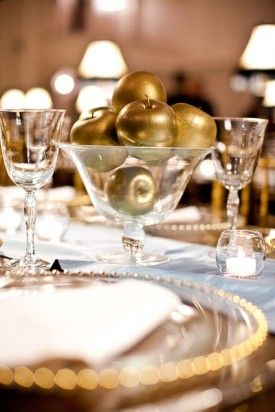 Gold Apple Centerpieces... this gave me a great idea