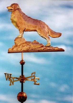 Bernese Mountain Dog Weathervane  by West Coast Weather Vanes.  Customers can provide photographs of their special canine pets for a customized  weather vane depicting  their favorite dog.  Glass eye color can be selected to accommodate a  variety of dog eye colors.  As an option, the use of brass or gold leafing can accentuate the multicolor markings of their dog.