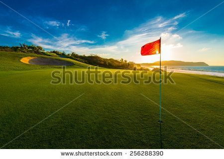 Red flag at the beautiful golf course at the ocean side at sunset, sunrise time. #beautifulgolfcourses
