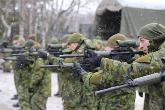 Canadian soldiers practice their shooting skills during Operation UNIFIER
