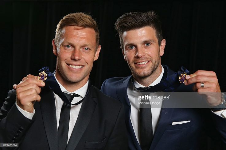 Sam Mitchell (L) of the West Coast Eagles (formerly of the Hawthorn Hawks) and Trent Cotchin of the Richmond Tigers pose with their Brownlow Medals during the 2012 Brownlow Medal presentation on December 13, 2016 in Melbourne, Australia.