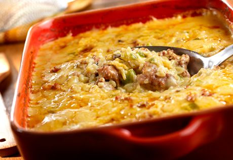 This sausage and rice casserole is seasoned with onions, green peppers and a creamy sauce...when you're in the mood for something especially tasty, give this dish a try!