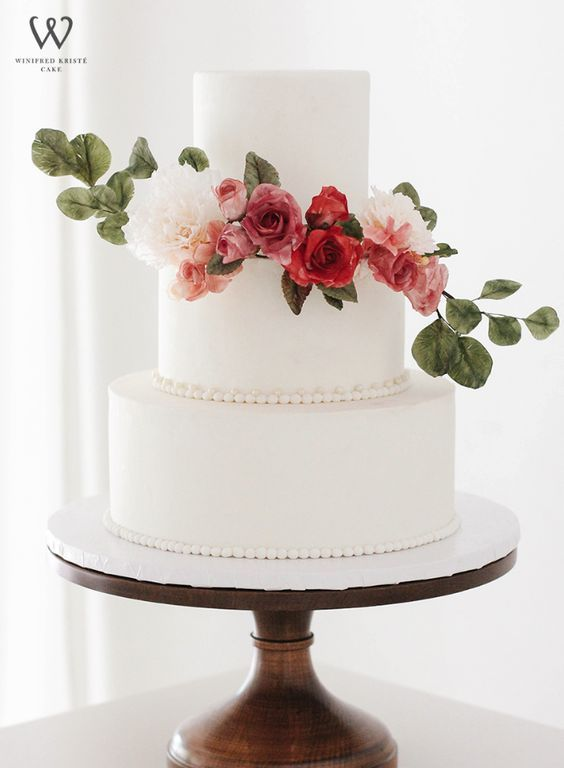 Classic three tier white wedding cake with elegant red flowers; Featured Cake: Winifred Kristé Cake