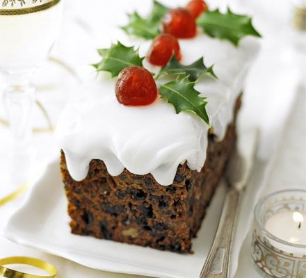 Snow-topped holly cakes. This square Christmas cake is cut into two loaf-shaped cakes, so you can give one to a friend