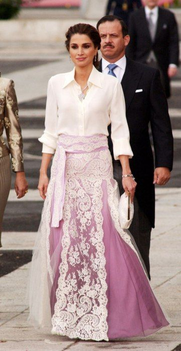 HER MAJESTY QUEEN RANIA OF JORDAN  Year Inducted: 2006 - Style Hallmarks: Shown here in ethereal purple and lace going into a cathedral for a Spanish royal wedding, Queen Rania's conservative, head-of-state glamour belies her vivacious beauty. A veteran of People's Most Beautiful lists, she is also highly educated, and prior to her coronation worked for Apple.