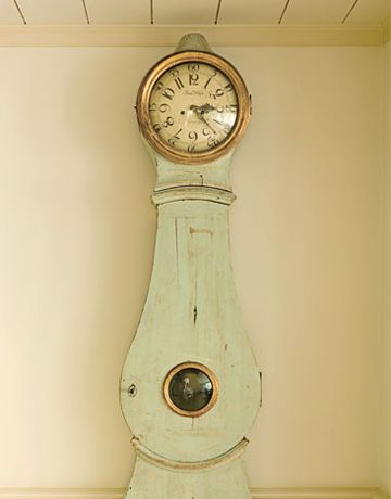 """""""No Swedish house is complete without a longcase clock.""""  This one is in a Houston home in Swedish style, by Carol Glasser and Katrin Cargill.  Photo by Karyn R. Millet.  Mora clock."""