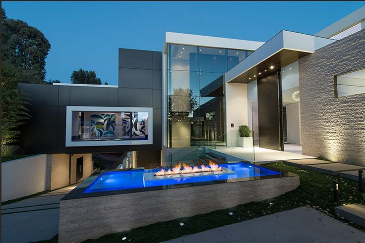 While it's not an actual moat, the swimming pool of this incredible spec house actually does extend around more than half the exterior of this Whipple Russell architect designed modern mansion. Description from smashingreader.com. I searched for this on bing.com/images