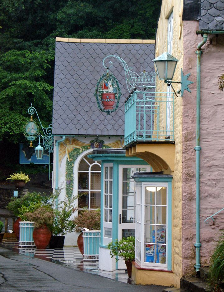 Portmeirion Village, Wales  i love porthmerion...just a mile down the beach from where i had my holiday home...awesome sights and awesome people...i miss being there for most of the year