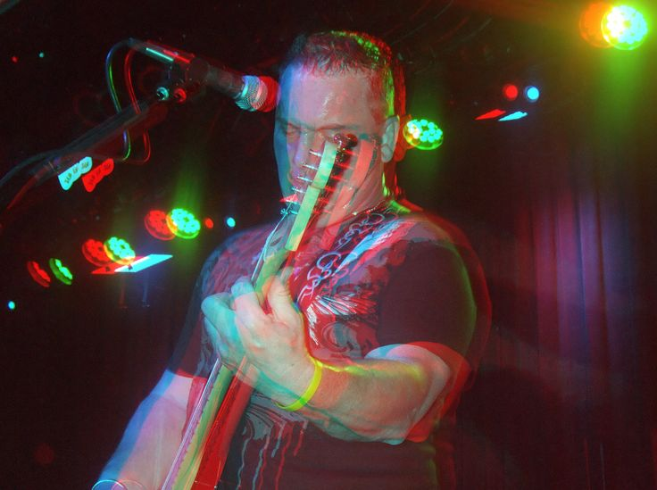A candid 3D anaglyph format out-of-screen photo taken at a Some Years Later Chicago alternative rock band gig.