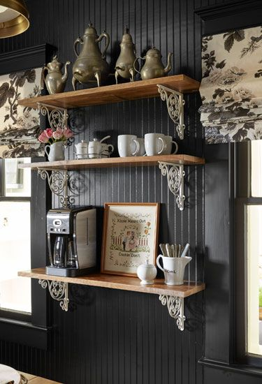 Bailey McCarthy Texas Farmhouse - same shelves stacked...the silver pops against the black wall.