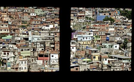 This photo shows one of the biggest favelas of Rio. It is called Alemao which means Germany. The legende tells that in the 60s a Lufthansa airplane crashed into this favela and tha´s why it is called Alemao. This image was taken through a window of one of those small homes.