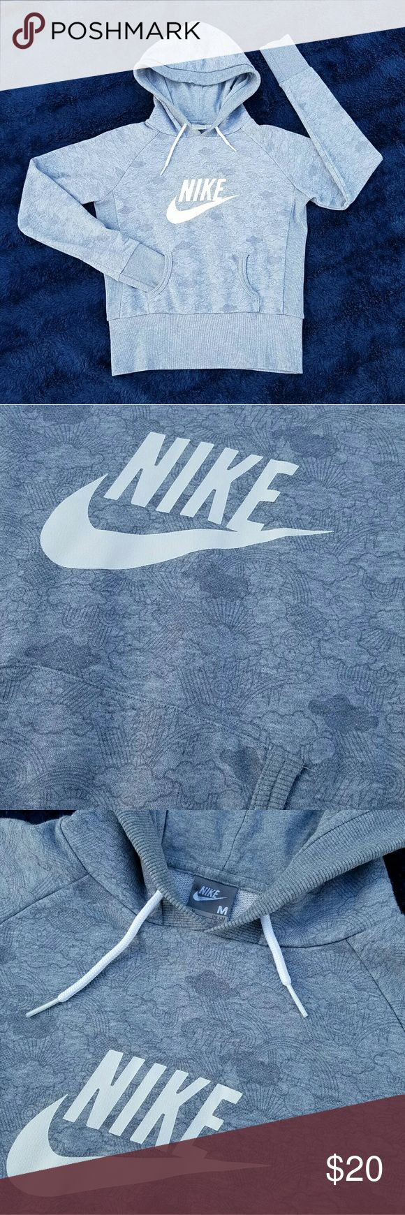 """Nike hoodie Grey Nike hoodie. There is a subtle but darker grey colored print of rainbows, clouds, sunshine, stars and """"NIKE"""" in the fabric. Nike Tops Sweatshirts & Hoodies"""