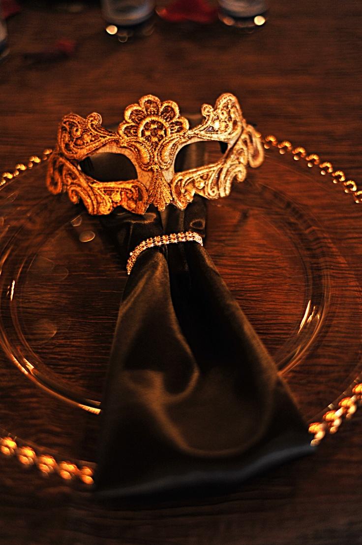Italian themed wedding decor. Balocoloc Venetian masks used as table setting accents.