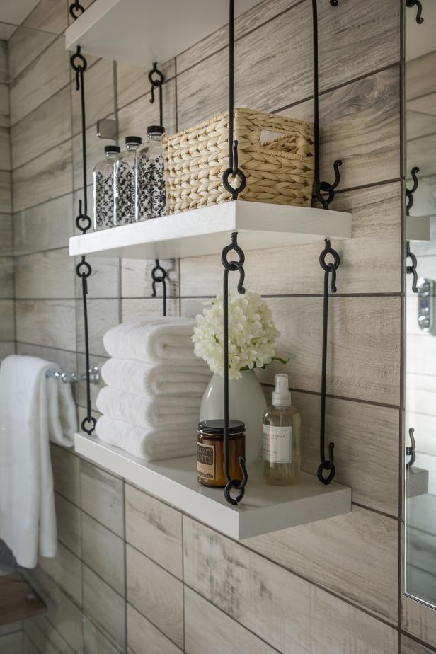 Clever hanging storage maximizes space in the HGTV Smart Home 2015  universal design bathroom. - Best 10+ Hanging Bookshelves Ideas On Pinterest Shelves
