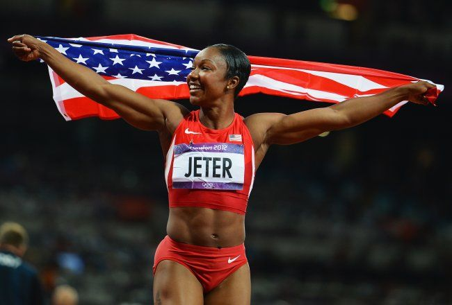Carmelita Jeter, my new girl crush. Strong, feminine and crazy FIT! Wow!