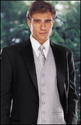 Black tux with silver vest and tie for all the grooms men. #DBBridalStyle