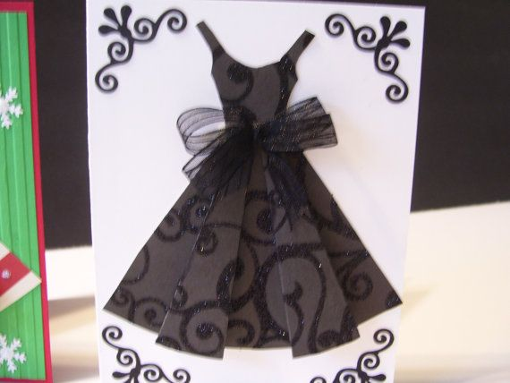 I made the card with heavy white cardstock. I used beautiful designer black glitter glazed paper. Tied a black bow at the waist. Cutout fancy