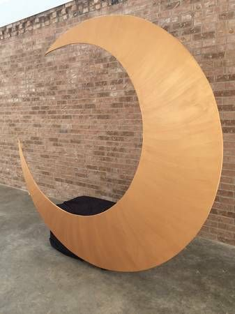"""Large wood crescent moon photo booth prop. 8'x8'x2' copper / rose gold paint, freestanding, built-in bench behind moon allows you to """"sit on the moon"""" :) Solid wood, very sturdy, but easy for two people to carry (or one person if bench is removed)! Could also be taken apart and moon displayed on a wall or suspended from ceiling without the bench."""