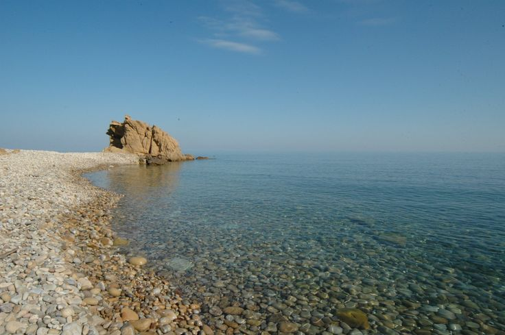 The transparent waters and pebbly beach of Castel di Tusa